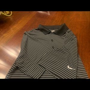 Men's NIKEGOLF dri-fit shirt.